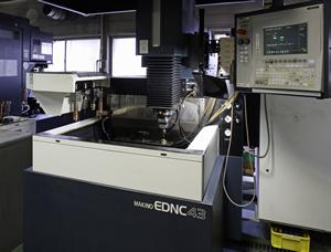 (13) NC electric discharge machine